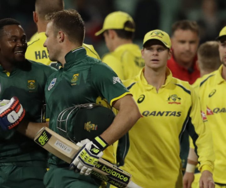 South Africa's batsman Andile Phehlukwayo, left, with teammate David Miller, leaves the field after scoring the winning runs during the third one-day international cricket match between South Africa and Australia, at Kingsmead stadium in Durban, South Africa, Wednesday, Oct. 5, 2016. (AP Photo/Themba Hadebe)