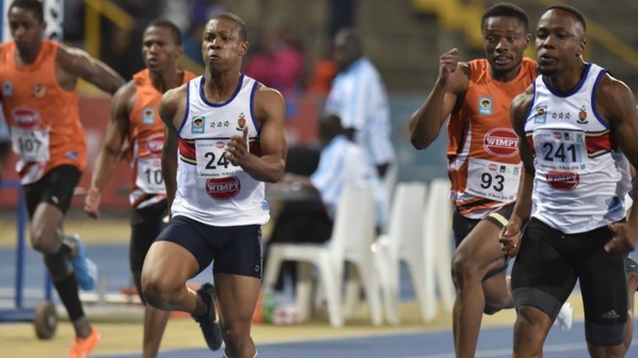 2016 FNB Varsity Athletics, Friday 18 February, at Uj Sport Stadium, Johannesburg Gauteng. Thando Roto of Tuks and team amte Akane Simbane in the 100m for men Photo by: Catherine Kotze/SASPA
