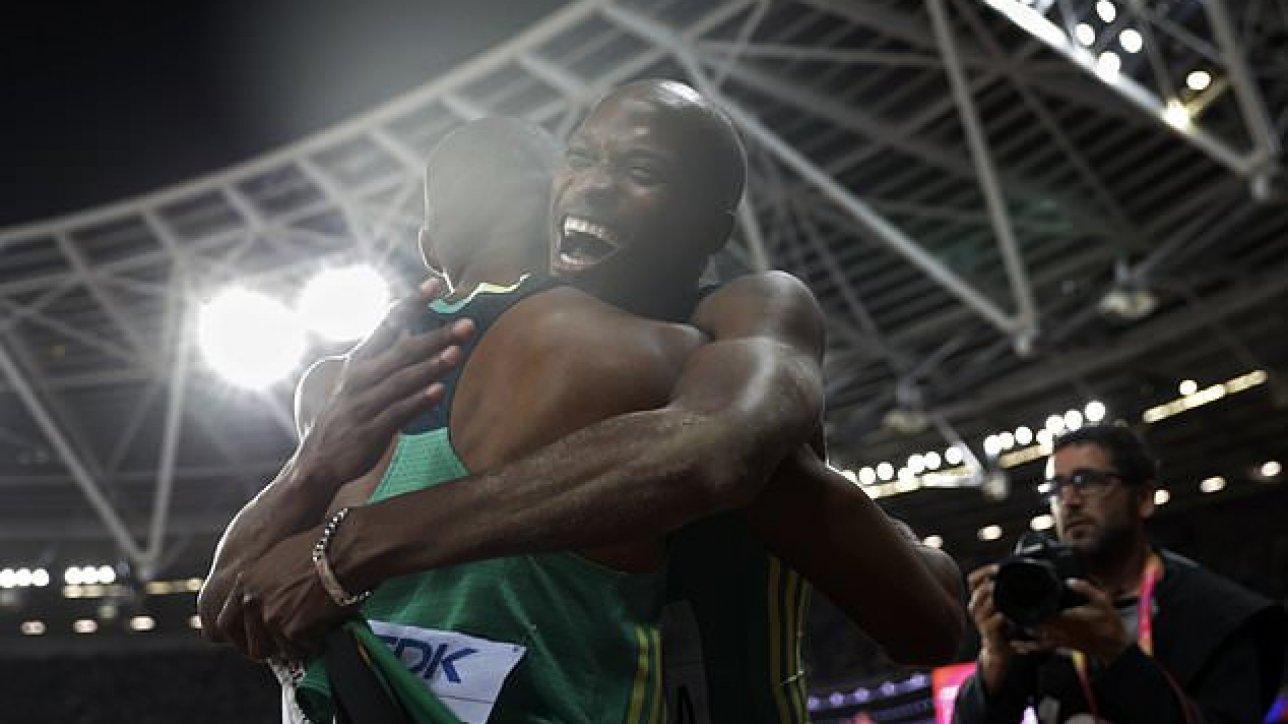 South Africa's gold medal winner Luvo Manyonga, right, is congratulated by his teammate South Africa's Ruswahl Samaai after the men's long jump final during the World Athletics Championships in London Saturday, Aug. 5, 2017. (AP Photo/Matthias Schrader)